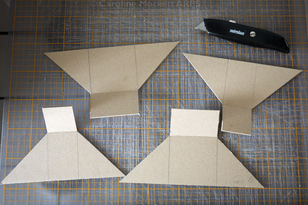 2. Cut out the funnel shapes with the stanley knife