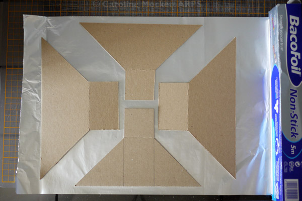 3. Lay out the card shapes on some kitchen foil