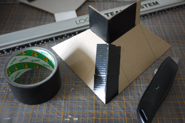 11. Fasten the corners with the duck tape