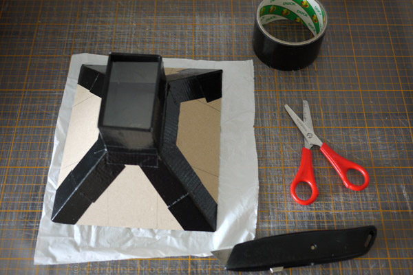 14. Lay out the opaque plastic from the carrier bag and cut out