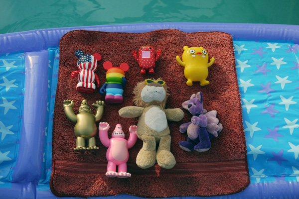Toys relax on a lilo