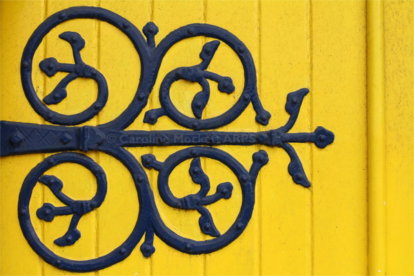 The Blue Hinge On The Yellow Door
