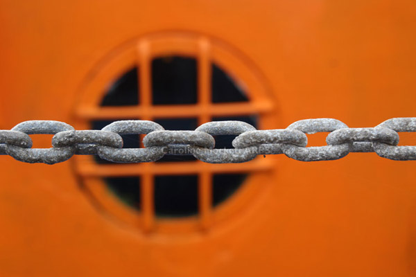 Orange Porthole And Chain