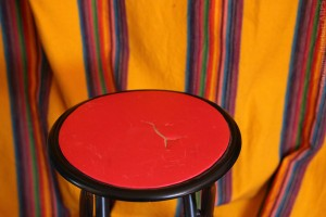 Red Stool And Curtain