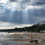 Crepuscular Rays Over The Beach